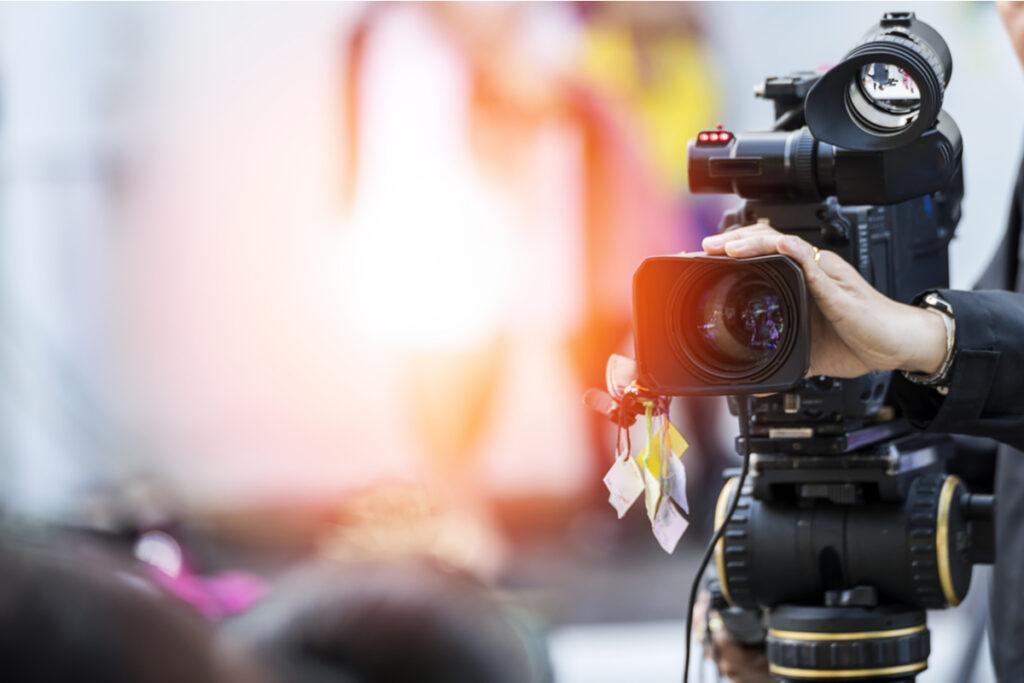 Video camera operator using his equipment